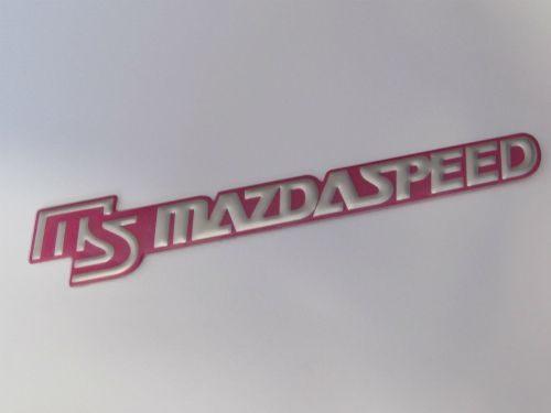 jual-aksesoris-mazda-speed-emblem-tempel-pink