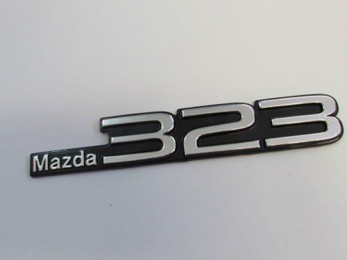 jual-murah-emblem-mazda-323-ukuran-17x3cm